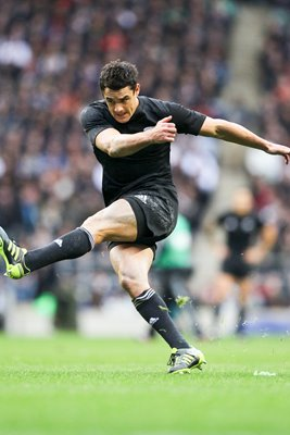 Dan Carter of New Zealand kicks at goal