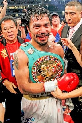 Manny Pacquiao with belts v Antonio Margarito