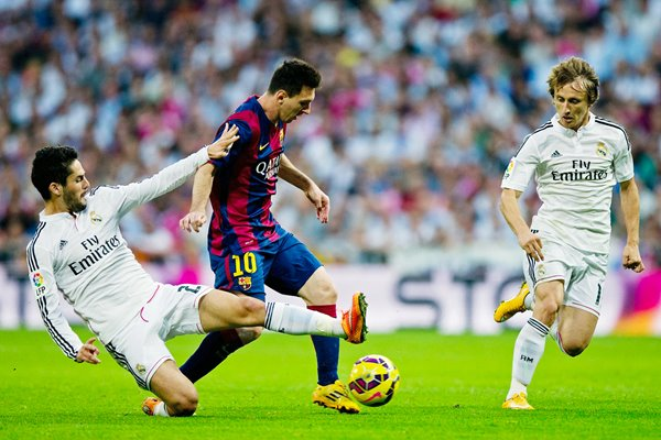 Isco Real Madrid tackles Lionel Messi Barcelona