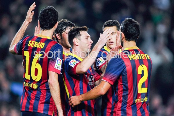 Messi of Barcelona celebrates with teammates