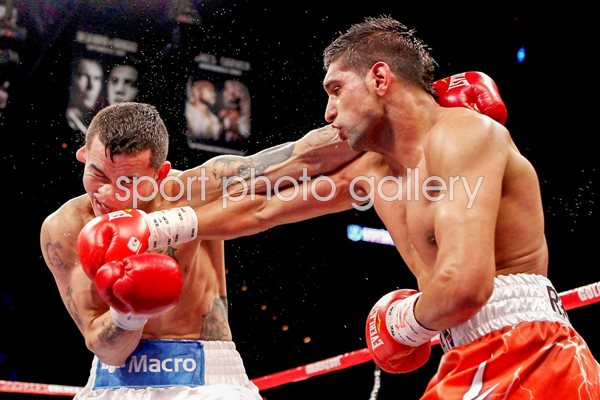 Amir Khan connects v Marcos Maidana Images | Boxing Posters | Amir Khan