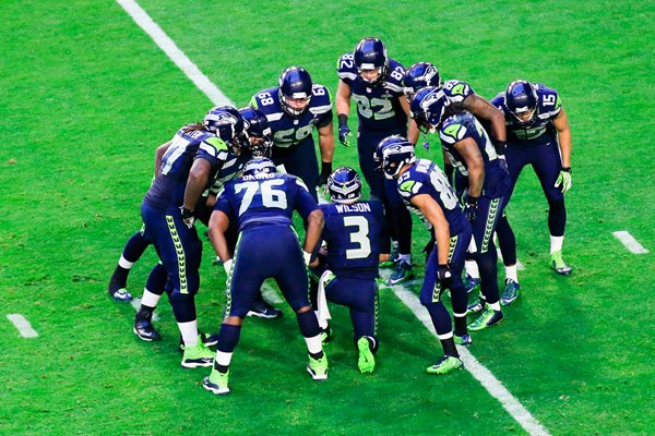 Team Huddle Seahawks v Patriots Glendale 2015